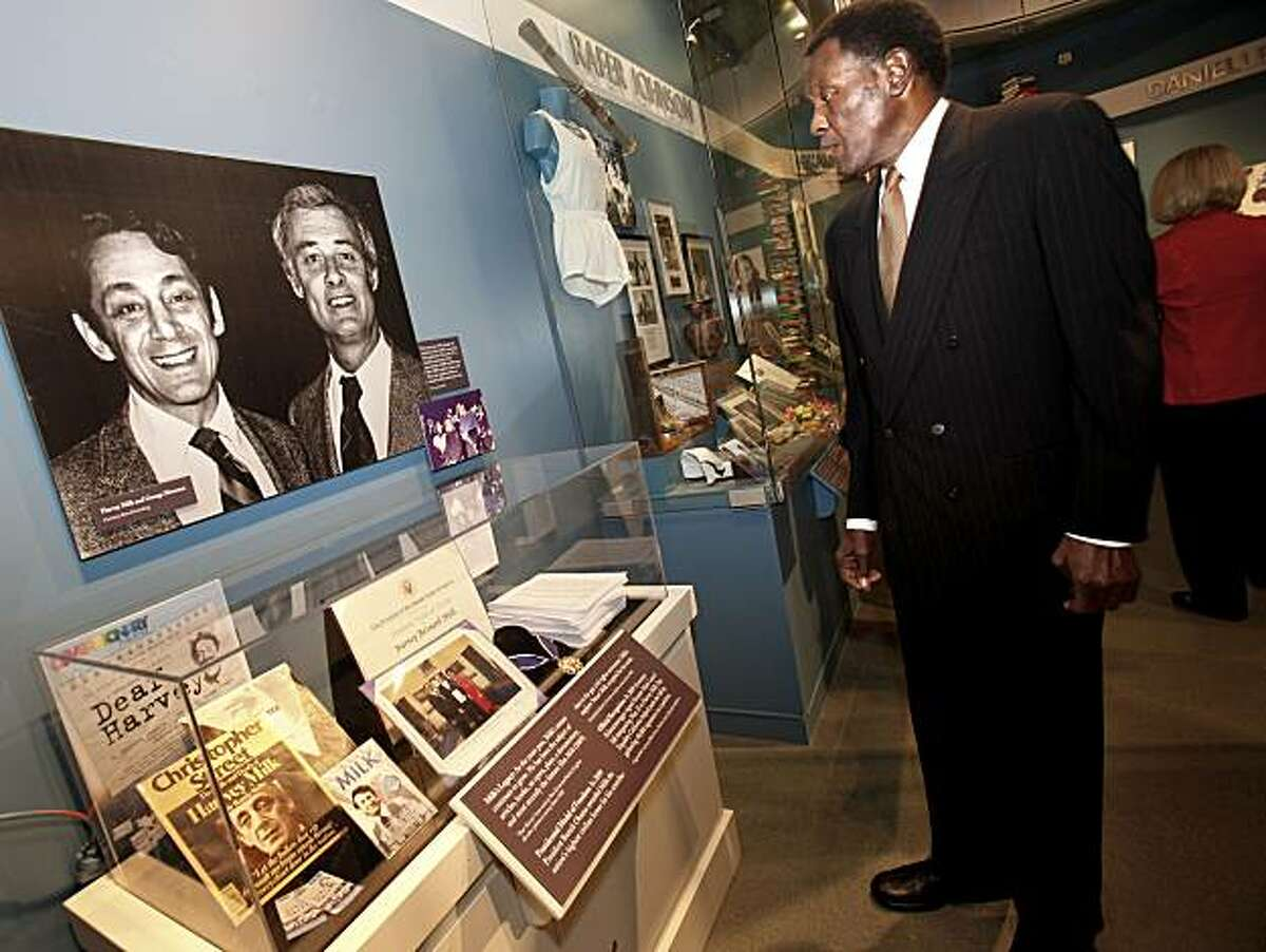 California Hall of Fame inductee Rafer Johnson looks over the Harvey Milk exhibit Tuesday.