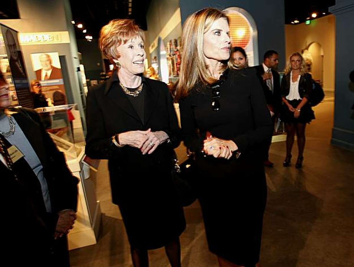 Carol Burnett and Maria Shriver look over the exhibits about the California Hall of Fame inductees on Tuesday in Sacramento.