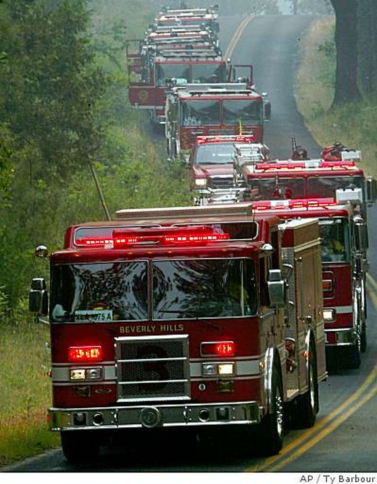 Cal Fire engines, mostly from Southern California, pour into the Camelot subdivision for structure protection as the Empire fire grows in Butte County, CA., Tuesday June 24, 2008. In less than a day, an electrical storm unleashed nearly 8,000 lightning strikes that set more than 800 wildfires across Northern California _ a rare example of