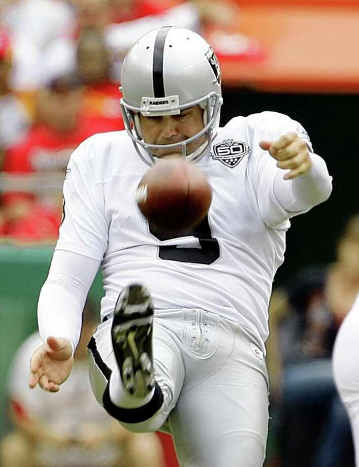 FILE- In this Sept. 20, 2009, file photo, Oakland Raiders punter Shane Lechler (9) kicks against the Kansas City Chiefs during the first quarter of a NFL football game in Kansas City, Mo. The Raiders' ineptitude on offense has been a boon to Lechler in his bid to break the NFL's single-season punting record.  Lechler is having his best season so far and is making his strongest bid yet to beat Sammy Baugh's 69-year-old record of 51.4 yards. he leads the NFL with a 52.3-yard average heading into Sunday's game against the Chiefs (AP Photo/Charlie Riedel, File) Photo: Charlie Riedel, AP