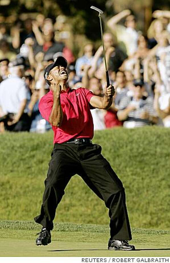 Tiger Woods celebrates sinking a birdie putt on the 18th hole to force a playoff with Rocco Mediate during the fourth round of the U.S. Open golf championship at Torrey Pines in San Diego June 15, 2008.     REUTERS/Robert Galbraith (UNITED STATES) Photo: ROBERT GALBRAITH, REUTERS