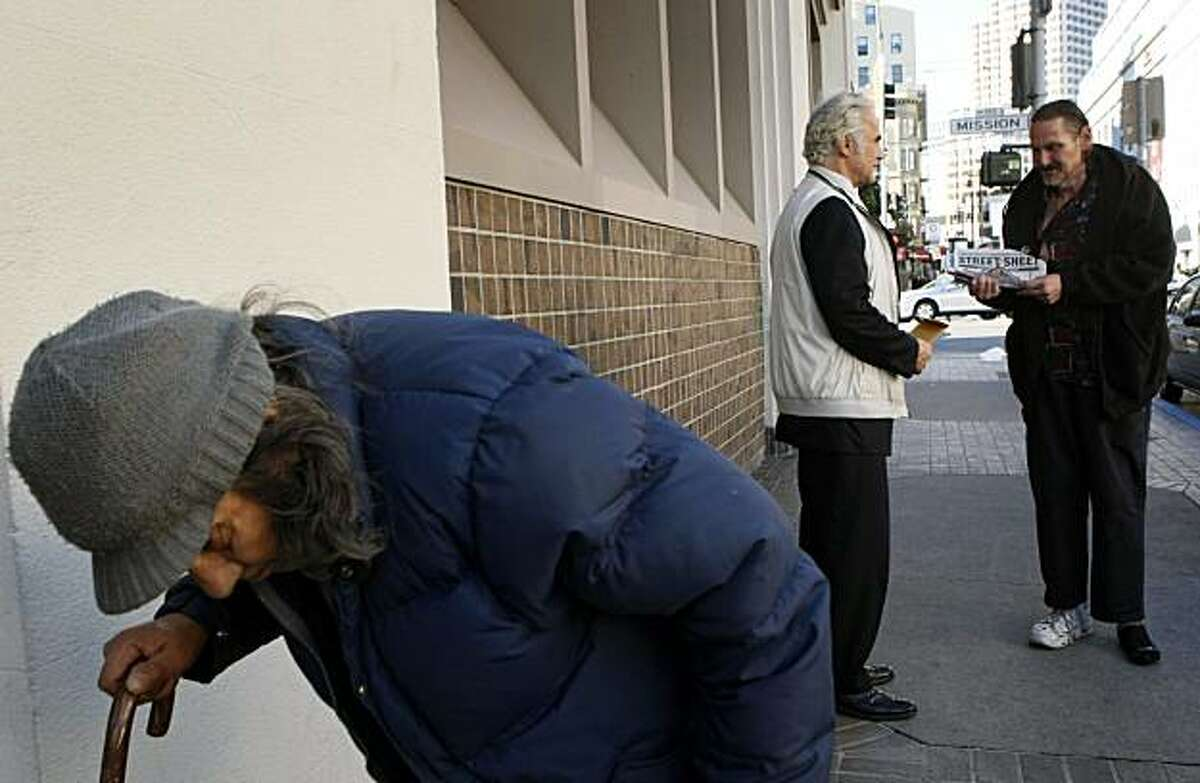 Phillip Mangano center is the former National Homeless policy Czar under both Presidents, George Bush and Barack Obama. Mangano stops to help a homeless man on 5th street while walking around San Francisco Wednesday November 19, 2009