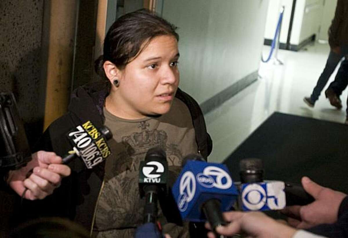 """Gabby Winder, 21, gives a statement to media outside San Francisco General Hospital on Monday after her partner, Rachel """"Ty"""" Brown, 24, was stabbed on the Muni's J-Church line."""