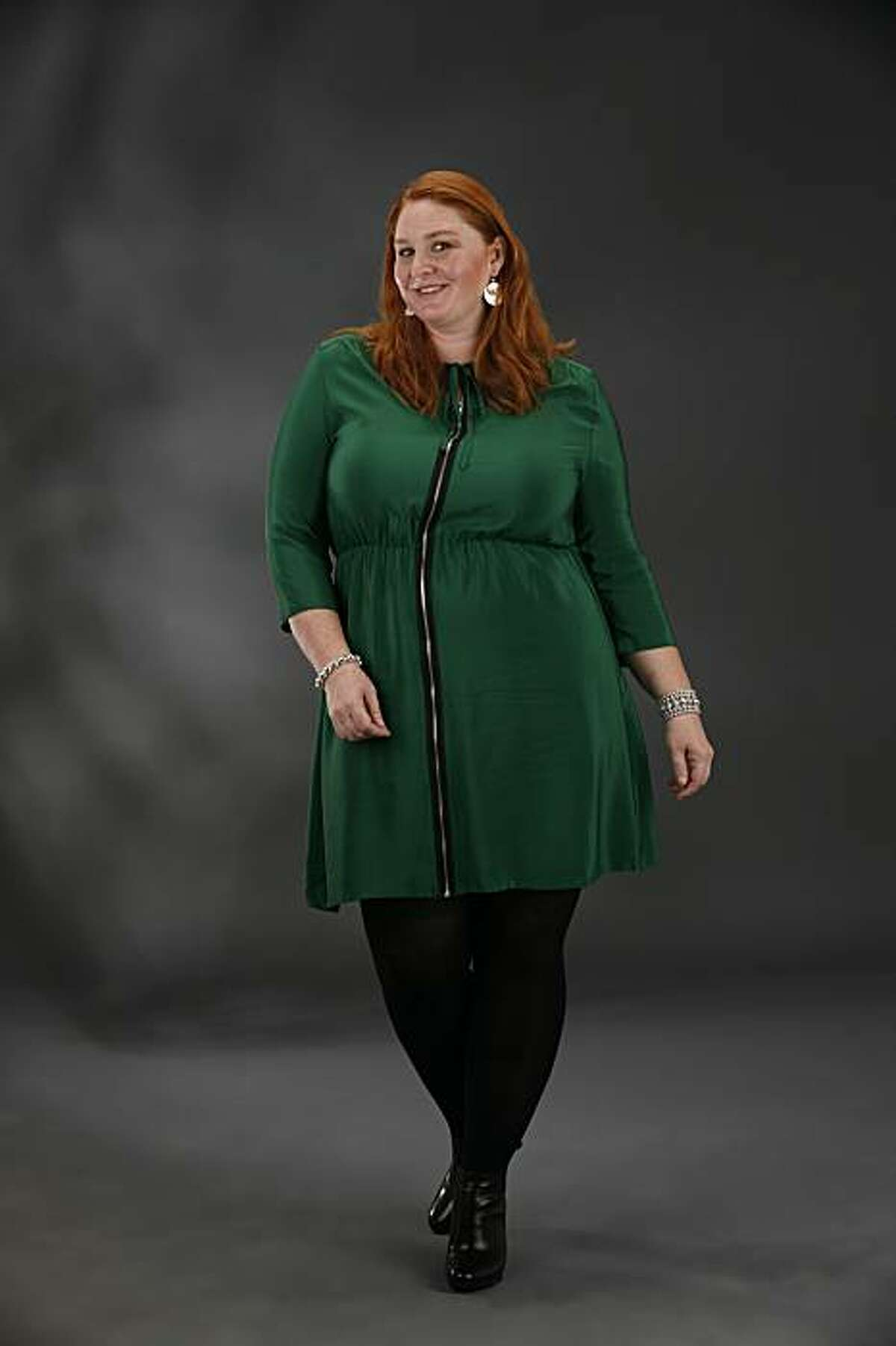 Model Dana Roeting of Marla Dell Talent SF shows an Amanda Uprichard silk zip front dress ($300, mariedenee.com); Via Spiga ankle boot ($260, Macy's West); and Betty Carre earrings ($40, Go Figure, San Francisco).
