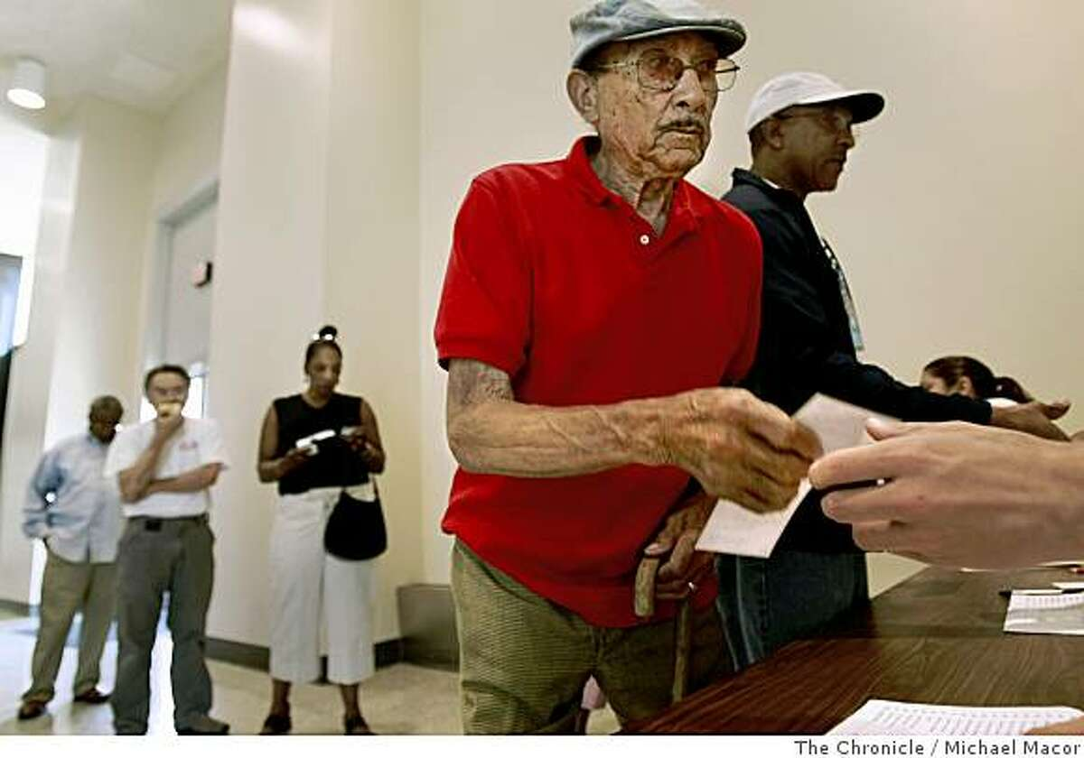 Bernard Smith gets a check for $500, on June 14, 2008, in Oaklland , Calif., after he turned in two guns last February during the the city's gun buyback program.Photo By Michael Macor/ The Chronicle