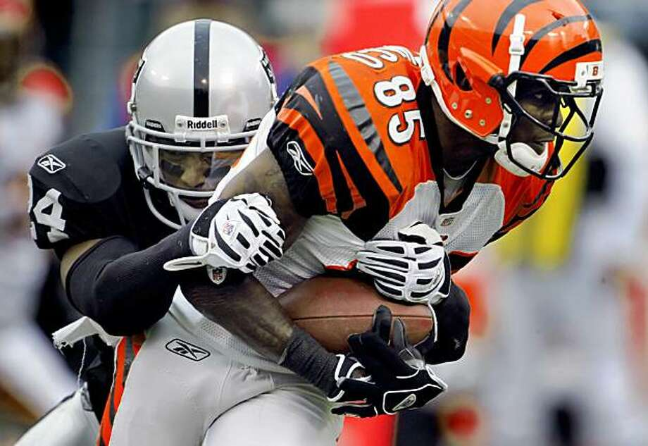 Michael Huff brings down Chad Ochocinco in the second quarter of the Raiders' game against the Bengals in Oakland on Sunday. Photo: Carlos Avila Gonzalez, The Chronicle