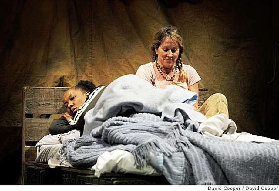 Lou (Kate Mulligan, right) shares her living quarters at Slab City with Jenny Sutter (Gwendolyn Mulamba) in Welcome Home, Jenny Sutter.Photo by David Cooper Photo: David Cooper