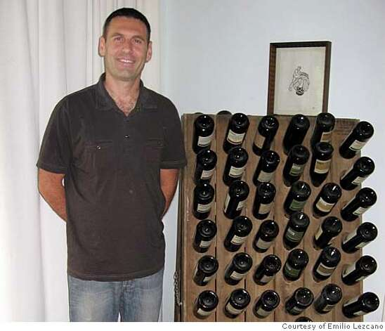 Golan Flam stands by a collection of wine. Photo: Xx