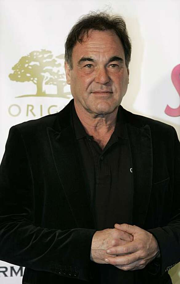 Director Oliver Stone appears on the green carpet at an event launching The Harmony Project during the Sundance Film Festival in Park City, Utah, on Sunday, Jan. 20, 2008.  The Harmony Project is meant to bring environmentalists and behavioral scientists together with members of the filmmaking, literary and new media communities. (AP Photo/Amy Sancetta) Photo: Amy Sancetta, AP