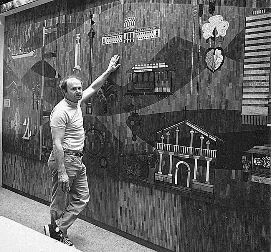 "Photo of Emile Norman in front of his wood inlay mural ""History of San Francisco,"" commissioned by Bank of California, now Union Bank of California. Circa 1964. Photo: Courtesy Brooks Clement"