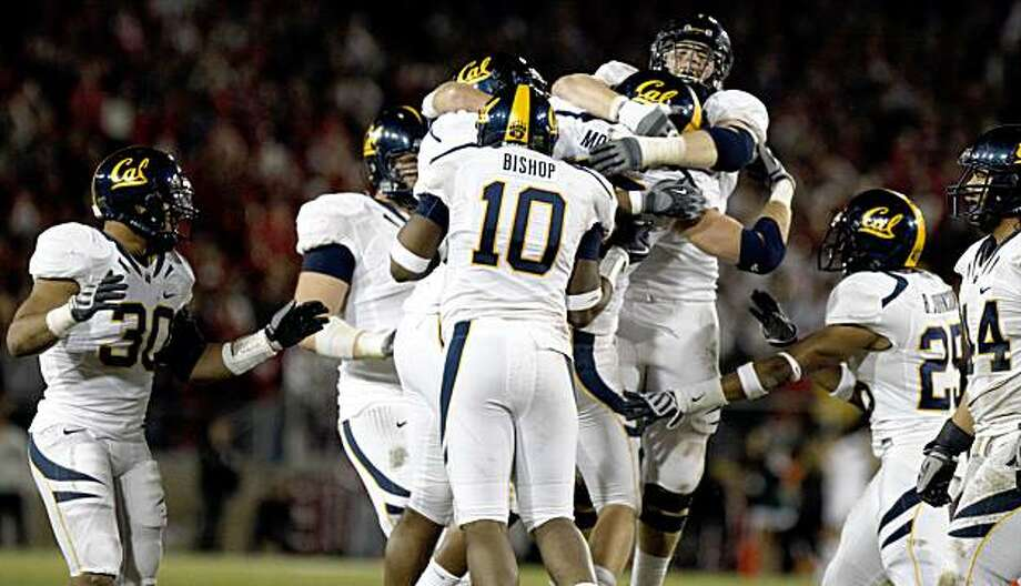 Cal's Mike Mohamed is mobbed by his teammates after he intercepted a pass from Andrew Luck in the red zone, sealing Cal's Big Game victory over Stanford in 2009. Photo: Lance Iversen, The Chronicle