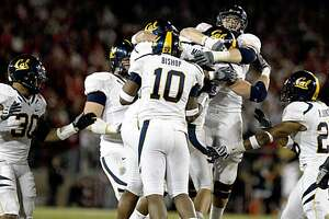 California Mike Mohamed is mobbed by his teammates after he intercepted a pass from Andrew Luck in the red zone sealing Cal victory over Stanford 34-28 Saturday November 21, 2009