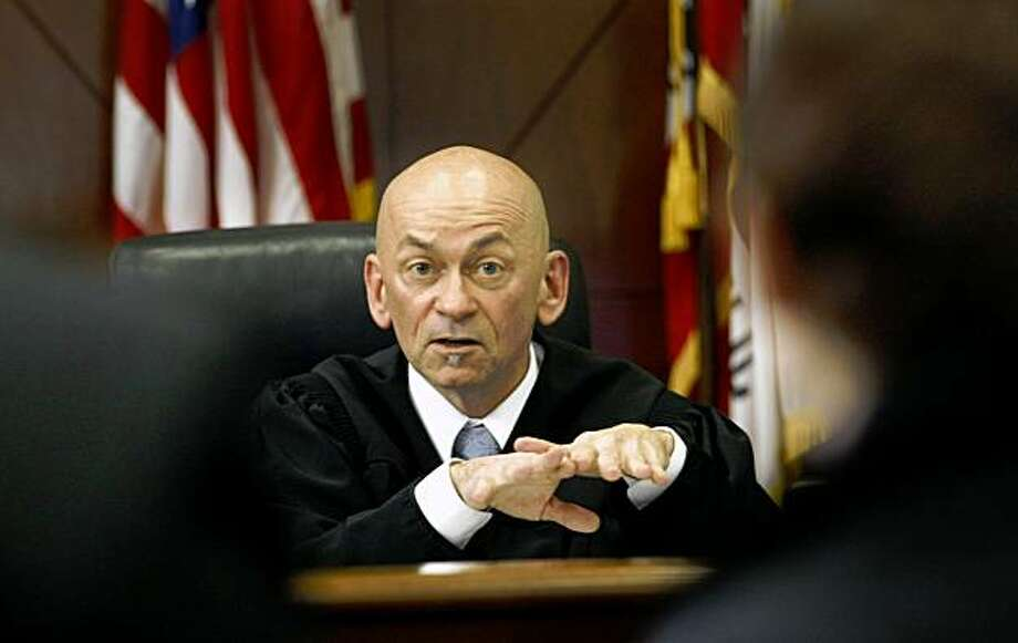 Judge Ron Albers checks in with people who have a criminal record in court, Friday Nov. 20, 2009, at the Community Justice Center in San Francisco, CAlif. Photo: Lacy Atkins, The Chronicle