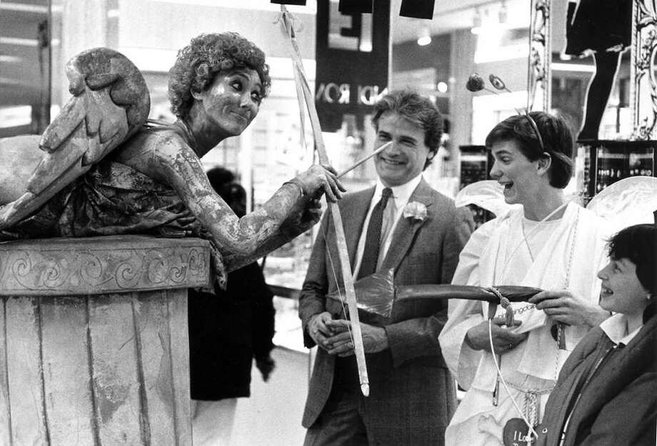 Feb. 13, 1987: Cupid meets Cupid as Ruby Lane, left, playing Cupid for Pastiche Inc.  meets Terry Mullane, second from right, playing Cupid in Bloomingdale's. With Terry are Bloomingdale's official David Horner and Tammy Neufeld, 12, of Stamford. Photo: File Photo