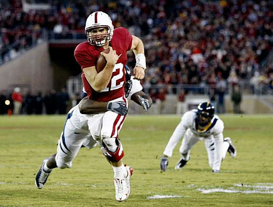 Stanford's Andrew Luck breaks through the line for a first quarter first down, setting up Stanford's second touchdown in the Big Game on Saturday. Photo: Lance Iversen, The Chronicle