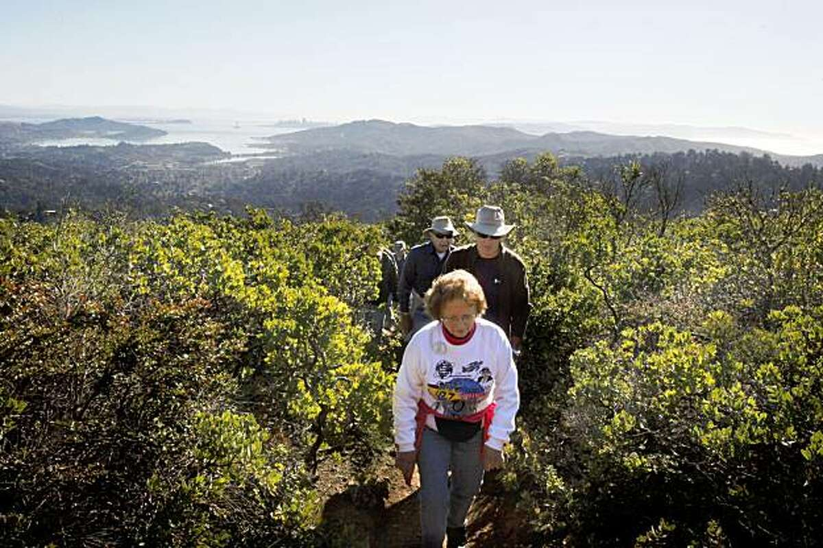 Pilot Joyce Wells (front) of the Gnoss Field Community Association hikes to the 1944 naval plane crash on Mt. Tamalpais in Mill Valley, CA, on Monday, November 23 , 2009. On the last day of November, 1944, a navy plane crashed into the side of Mt. Tamalpais killing all eight aboard.
