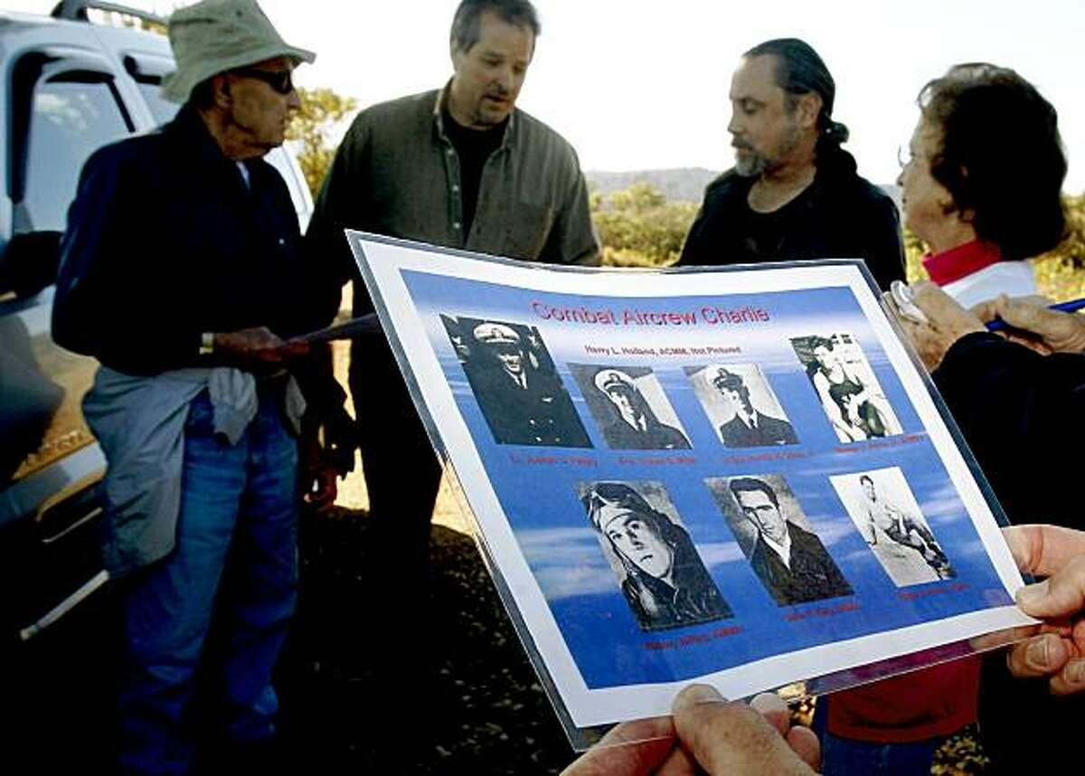 Pilots of the Gnoss Field Community Association learning about the downed passengers of the 1944 naval plane crash on Mt. Tamalpais in Mill Valley, CA, view a picture of 7 of the passengers on Monday, November 23 , 2009. On the last day of November, 1944, a navy plane crashed into the side of Mt. Tamalpais killing all eight aboard.
