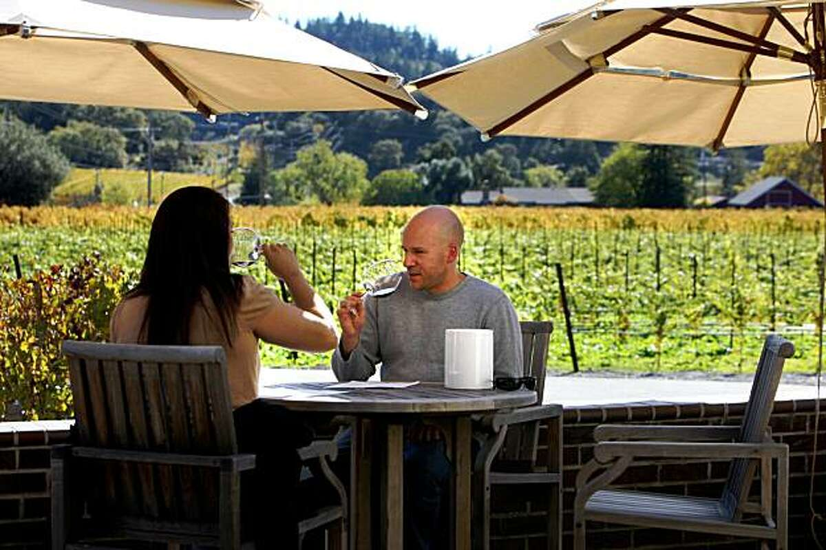 Mandy Kellogg, left, and Mike Kellogg, both of Rutherford, enjoy a wine tasting on the patio at the Baldacci Family Vineyards in Napa Valley, Monday, November 23, 2009.