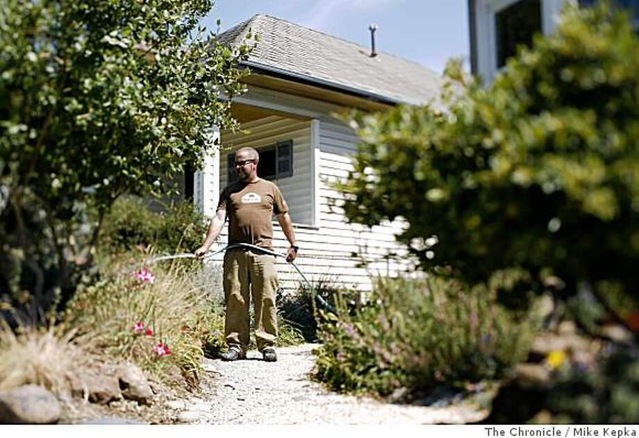Landscape architect with East Bay Wilds, Pete Veilleux, maintians a clients front yard.on Tuesday May, 27, in Oakland, Calif. Photo: Mike Kepka, The Chronicle