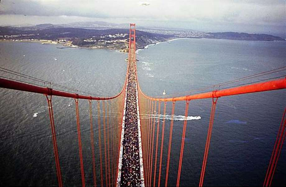 50th Anniversary of the Golden Gate Bridge on May 22, 1987.  hundreds of thousands people walked on the traffic lanes of the bridge, as it was closed to traffic all day.  View is from the top of the south tower looking north to Ft. Point. Photo: Mike Maloney, The Chronicle