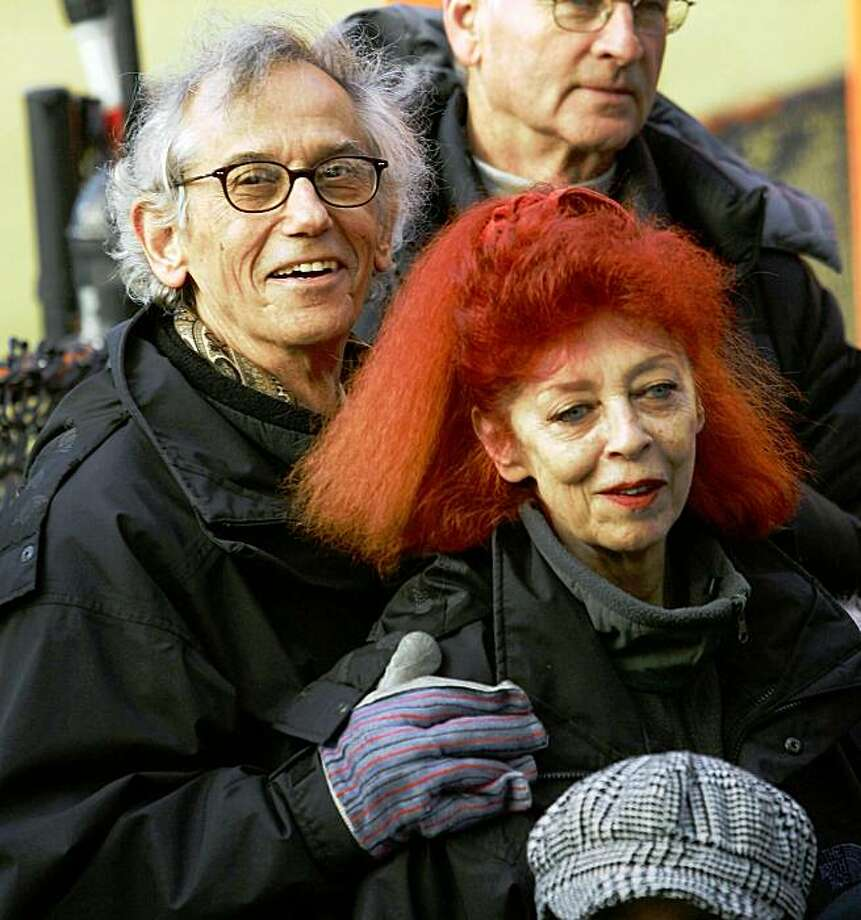 "NEW YORK - FEBRUARY 12:  (FILE PHOTO)  Artists Christo (L) and Jeanne-Claude (R) watch the unfurling of one of the gates in the ""The Gates, Central Park, New York, 1979-2005'"" exhibit at Central Park February 12, 2005 in New York City. ThAccording to reports, Jeanne-Claude, 74, died November 19, 2009 in New York City.   (Photo by Spencer Platt/Getty Images) Photo: Spencer Platt, Getty Images"