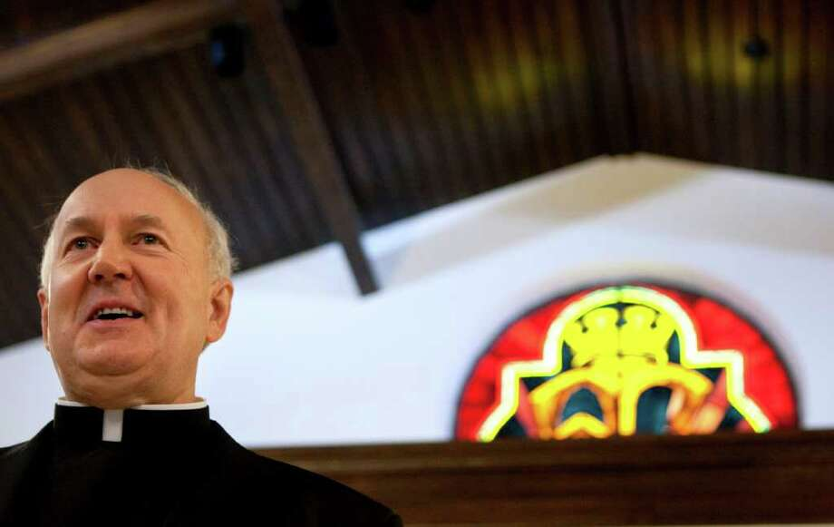 Rev. Jeffrey Steenson, a former Episcopal bishop who was named the Ordinariate Chair of Saint Peter by Pope Benedict XVI, addresses the media during a press conference at Our Lady of Walsingham Catholic Church Monday, Jan. 2, 2012, in Houston.  This is the second ordinariate in the world for former Anglican groups, which will be held at Our Lady of Walshingham parish. The fist was established to serve England and Wales. To date, more than 100 Anglican priests have applied to be ordained Catholic priests for the ordinariate. Fr. Steenson, who is married with three children,  became Catholic in December 2007. ( Johnny Hanson  / Houston Chronicle ) Photo: Johnny Hanson / © 2012  Houston Chronicle