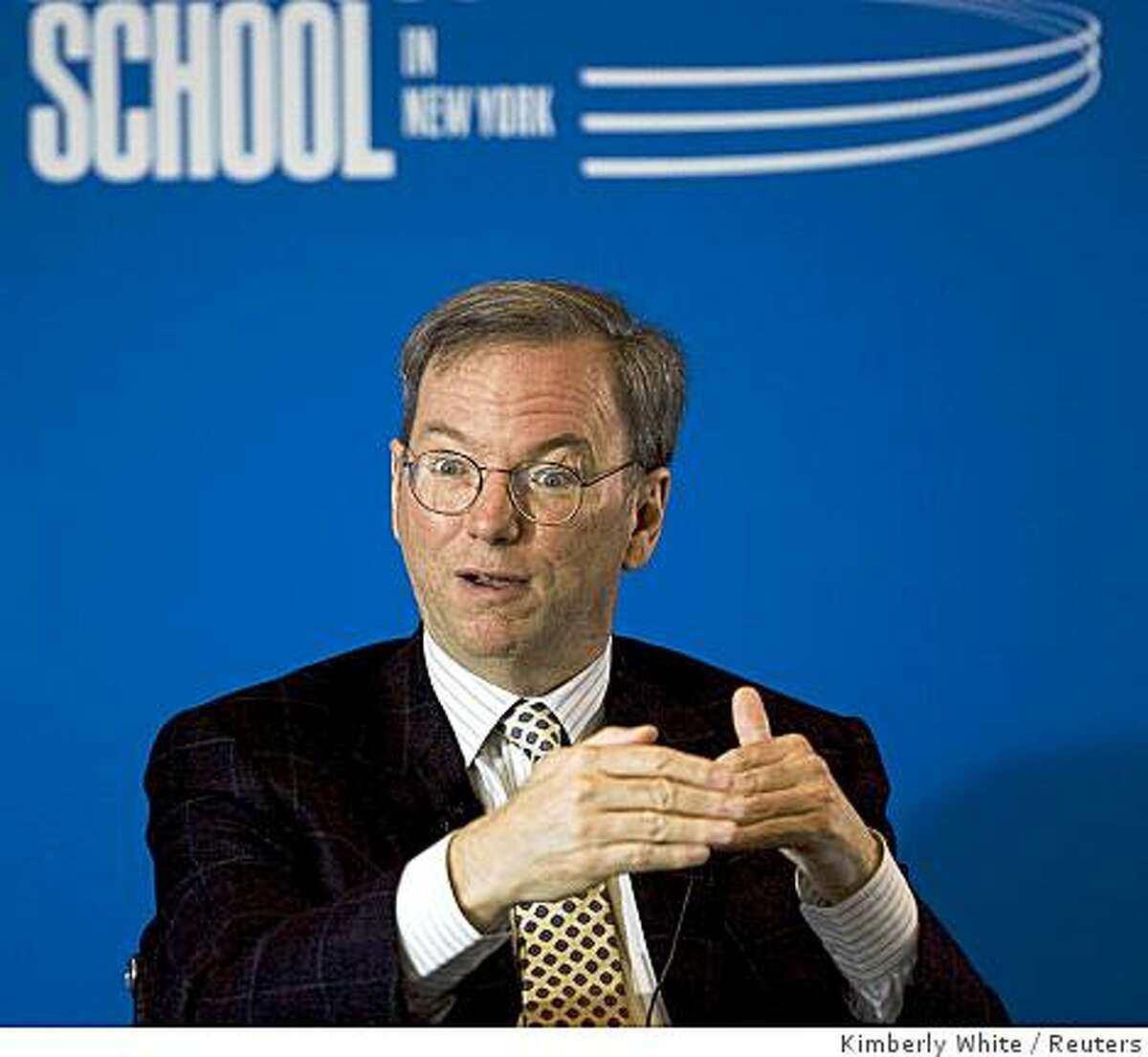 Despite growing signals that Google?s advertising pact with Yahoo may be challenged by regulators, Google CEO Eric Schmidt defended the deal Wednesday and said the company expected to implement it, as planned, in October.?Traffic and revenue have held up well despite uncertain economic conditions,? Eric Schmidt, Google?s chief executive, said.Eric Schmidt, Chairman and chief executive of Google Inc., speaks at an event held by Syracuse University in San Francisco, California, June 11, 2008. Schmidt discussed the company's motto