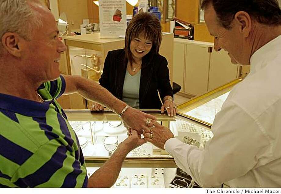John Hemm and Steve Weir continued with their plans for their June 17 wedding by traveling to the Concord, Calif., on May 31, 2008, stopping at the Macy's Department store to pick out rings for the big day.  Jewelry department salesperson Pricilla Lee helps out with the ring selections, after the California Supreme Court cleared the way approving gay marriage in the state.Photo By Michael Macor/ The Chronicle Photo: Michael Macor, The Chronicle