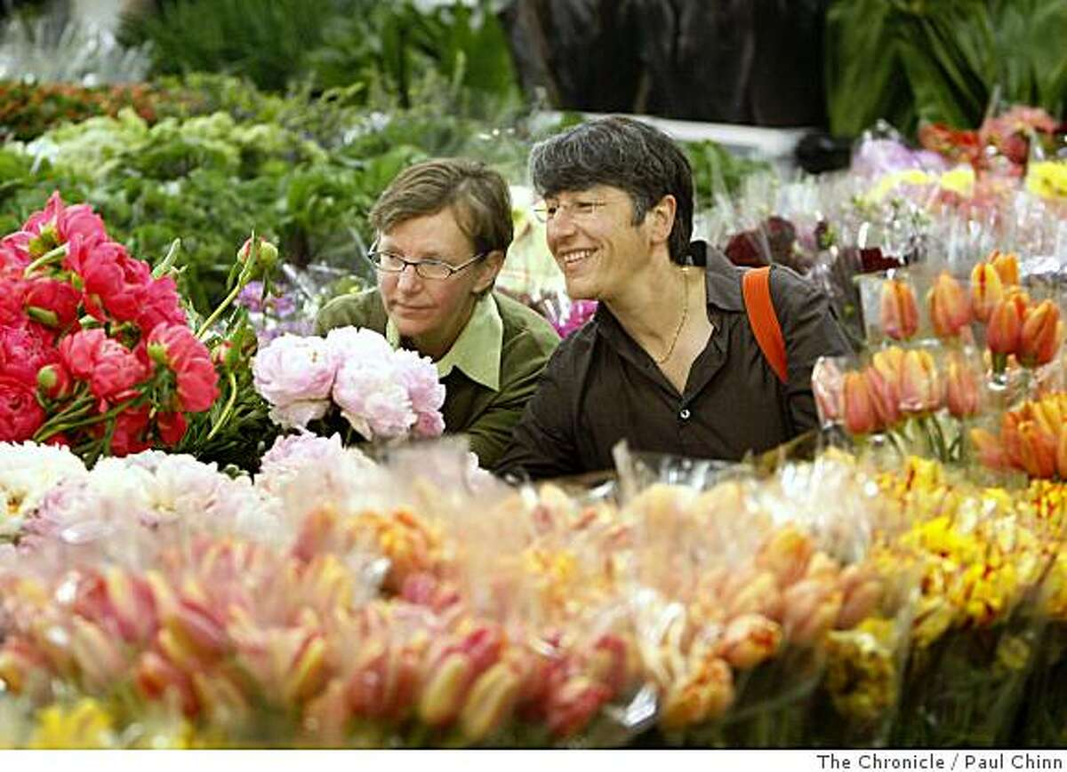 Elizabeth Kristen, left, and her partner Mali Kigasari browse through a flower display while shopping for wedding bouquets at the Flower Mart in San Francisco, Calif., on Tuesday, June 10, 2008. The Oakland couple will tie the knot at San Francisco City Hall on June 17, the first day same sex marriages are legal in California. Photo by Paul Chinn / The Chronicle
