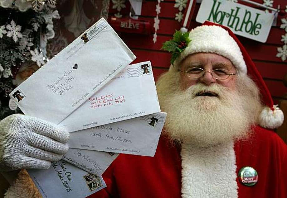 In this file photo, Santa Claus, also known as Patrick Farmer, at Santa Claus House in North Pole, Alaska Wednesday Nov. 18, 2009, holds letters from children sent this year that the U.S. Postal Service.  Photo: Sam Harrel, AP