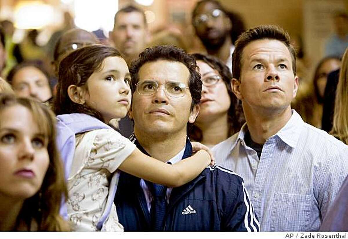 In this image released by Twentieth Century Fox, Ashlyn Sanchez, John Leguizamo,center, and Mark Wahlberg are shown in a scene from,