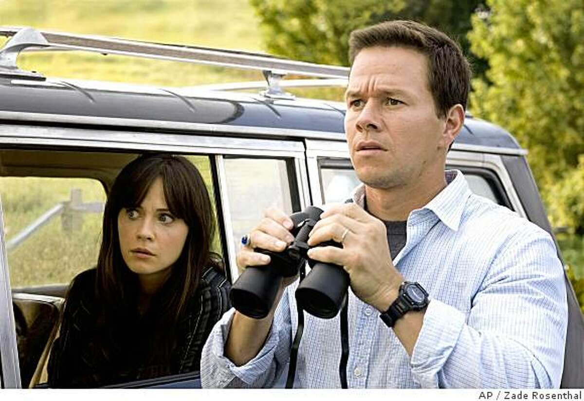In this image released by Twentieth Century Fox, Mark Wahlberg, right, and Zooey Deschanel are shown in a scene from,