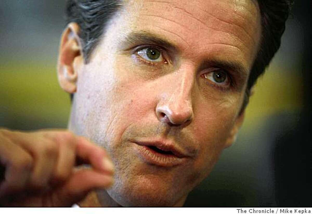 In front of a crowd of city employees and press, San Francisco Mayor, Gavin Newsom addresses his new budget plan in the San Francisco Police Department Tactical Operations center located in Hunter's Point Shipyard on Monday, June 1, 2008, in San Francisco,Calif.