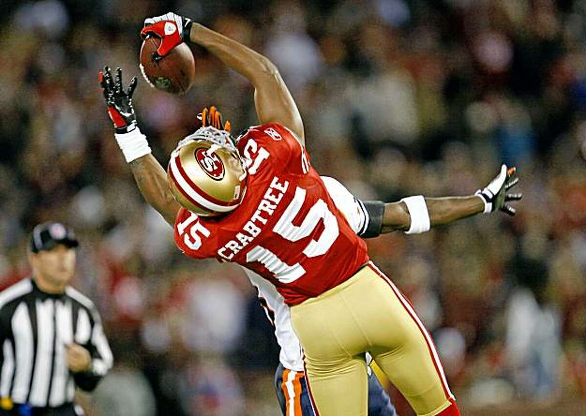 49ers Michael Crabtree makes a one handed catch from Quarterback Alex Smith. Afetr review it was later called incomplete San Francisco 49ers lead the Chicago Bears at the half 7-3 at Candlestick Park Thursday November 12, 2009.