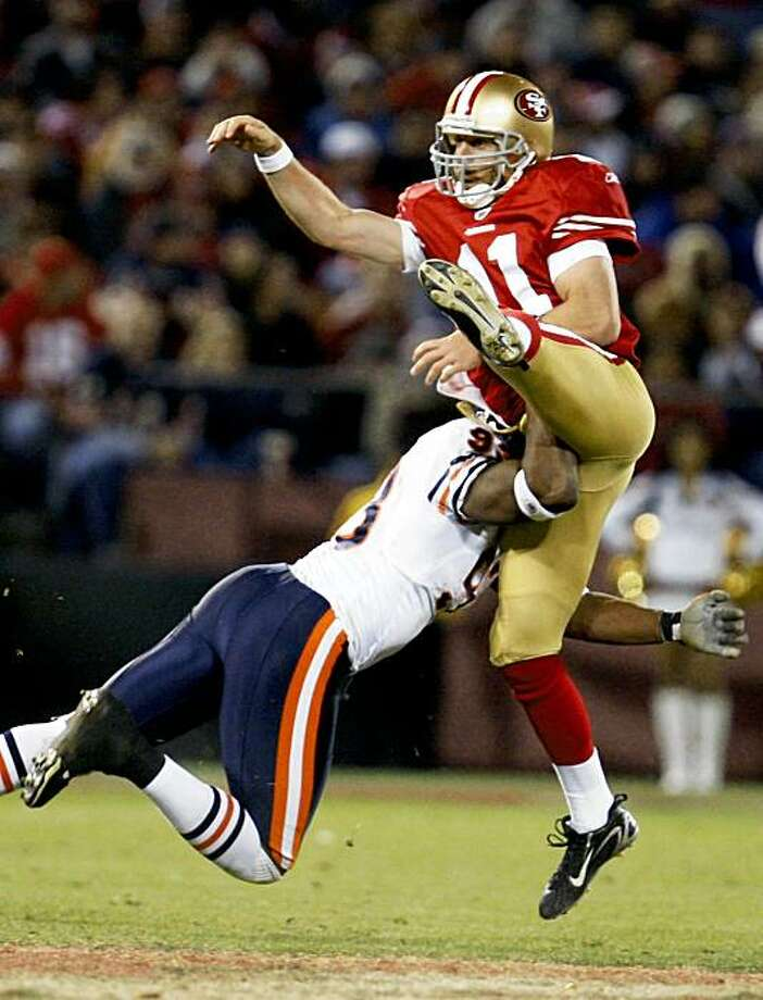 San Francisco 49ers Quarterback Alex Smith is hit after completing a pass late into the 4th quarter. San Francisco 49ers defeated the Chicago Bears at Candlestick Park Thursday November 12, 2009 10-6 Photo: Lance Iversen, The Chronicle