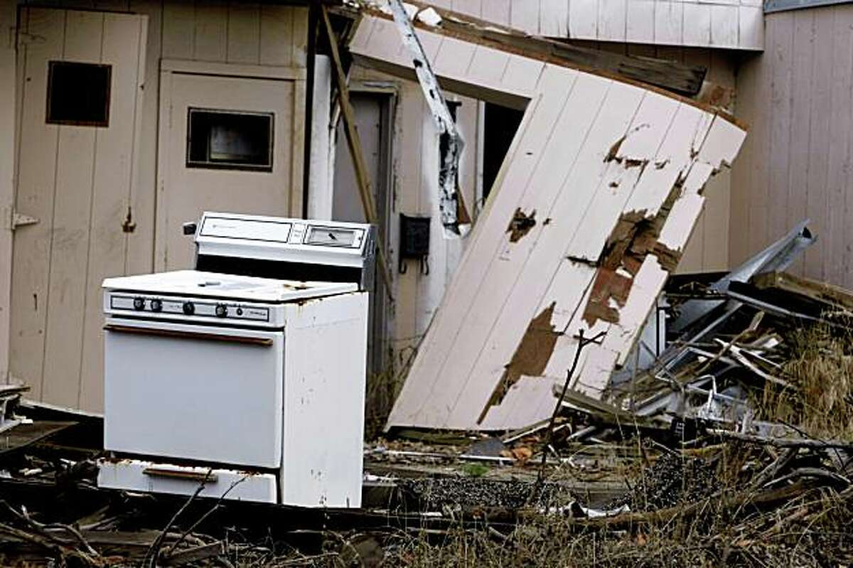 Kitchen appliances and debris litter an abandoned housing complex inside the site of the former Oak Knoll Naval Hospital in Oakland, Calif., on Thursday, Oct. 15, 2009. A group of neighbors have filed suit against Lehman Brothers, which went bankrupt, and has let the property fall into disrepair.