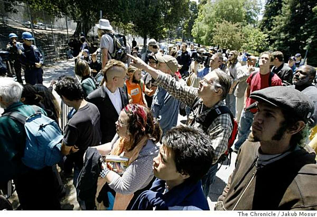 Onlookers watch as UC Berkeley began cutting ropes and removing gear from a grove outside of Memorial Stadium in Berkeley, Calif. on Tuesday, June 17, 2008. Photo by Jakub Mosur / Special to the Chronicle.