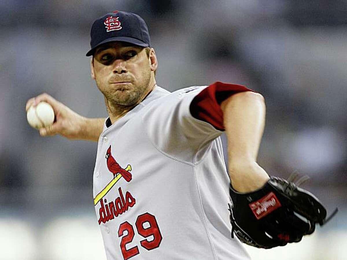 St. Louis Cardinals pitcher Chris Carpenter delivers during the first inning of a baseball game against the San Diego Padres Saturday, Aug. 22, 2009 in San Diego. (AP Photo/Denis Poroy)
