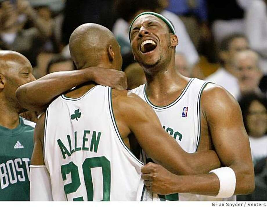 Boston Celtics players Ray Allen (L) and Paul Pierce celebrate their win over the Los Angeles Lakers in Game 6 of the NBA Finals basketball championship in Boston June 17, 2008. The Celtics win the NBA Championship with the win.   REUTERS/Brian Snyder (UNITED STATES) Photo: Brian Snyder, Reuters