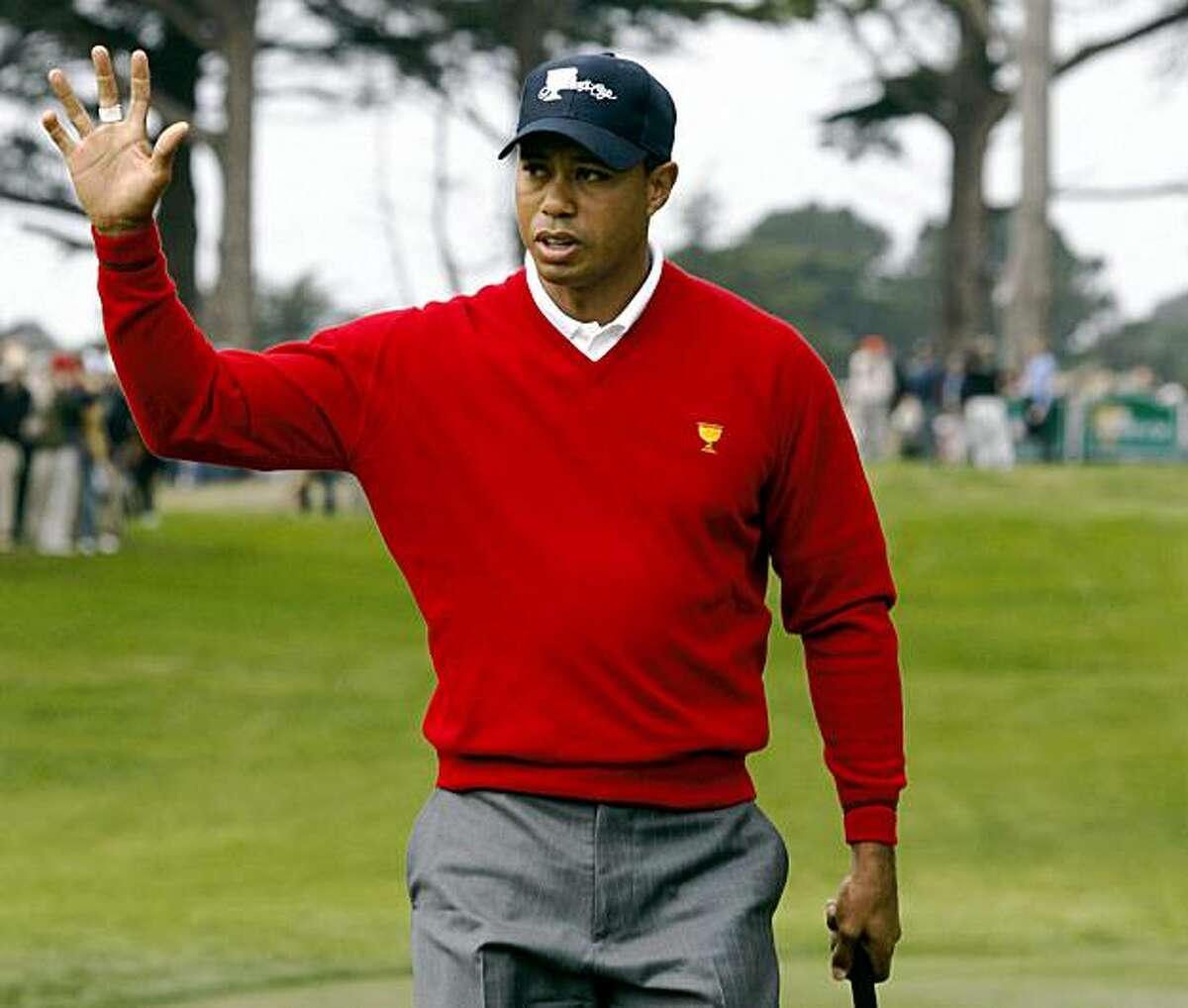United States Tiger Woods gestures to the galley after sinking a put on 2nd hole to score another point for the Americans over Geoff Ogilvy and Ryo Ishikawa from the International team in the first day of foursome Matches in the 2009 Presidents Cup at Harding Park in San Francisco California Thursday Oct 8, 2009 prezcup09