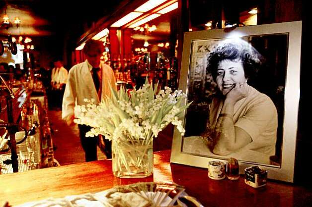 BALI11 A memorial photo of Armen Bali and a bouquet of flowers on the bar at a celebration at Tosca, a bar in North Beach owned by Jeanette Etheredge, to remember Armen Bali, a San Francisco restauranteur and arts maven who helped Russian dancers and other artists. These pictures were made in San Francisco, CA.  on Wednesday, Jan. 9, 2008.  KATY RADDATZ/The Chronicle Photo: KATY RADDATZ, SFC
