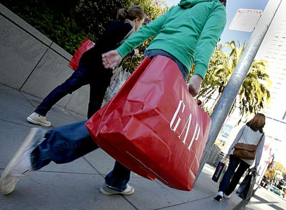 Shoppers make their way up Stockton Street on Cyber Monday, which may have claimed some shoppers at San Francisco's Union Square. Photo: Brant Ward, The Chronicle