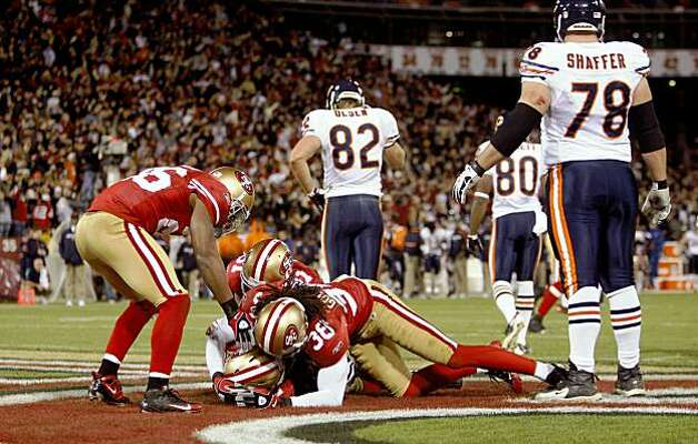 Teammates swarm San Francisco 49ers safety Michael Lewis after he intercepted a pass with seconds left in the game as the San Francisco 49ers beat the Chicago Bears 10-6  on Thursday November 12, 2009 in San Francisco, Calif. Photo: Michael Macor, The Chronicle