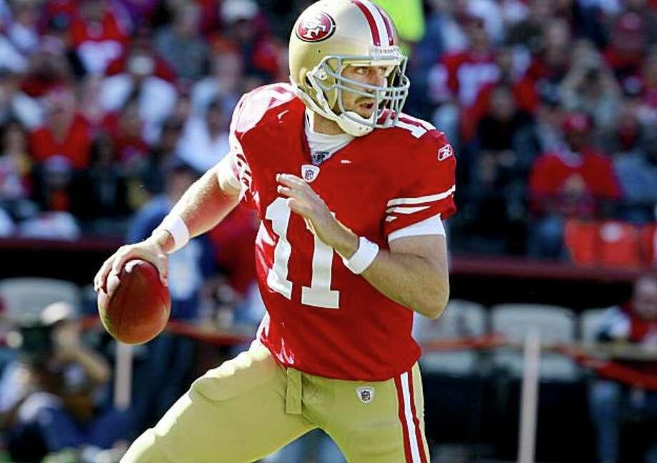 Alex Smith moved out of the pocket in the first half. San Francisco 49ers vs the Tennessee Titans at Candlestick Park Sunday November 8, 2009. The 49ers lost 34-27. Photo: Brant Ward, The Chronicle