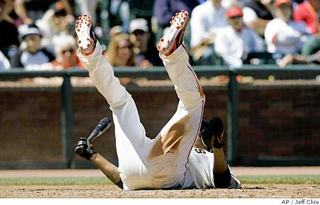 San Francisco Giants' Jose Castillo lies on the ground after avoiding a pitch by Oakland Athletics' Chad Gaudin in the seventh inning of a baseball game in San Francisco, Sunday, June 15, 2008. The Athletics won 5-3. (AP Photo/Jeff Chiu) Photo: Jeff Chiu, AP
