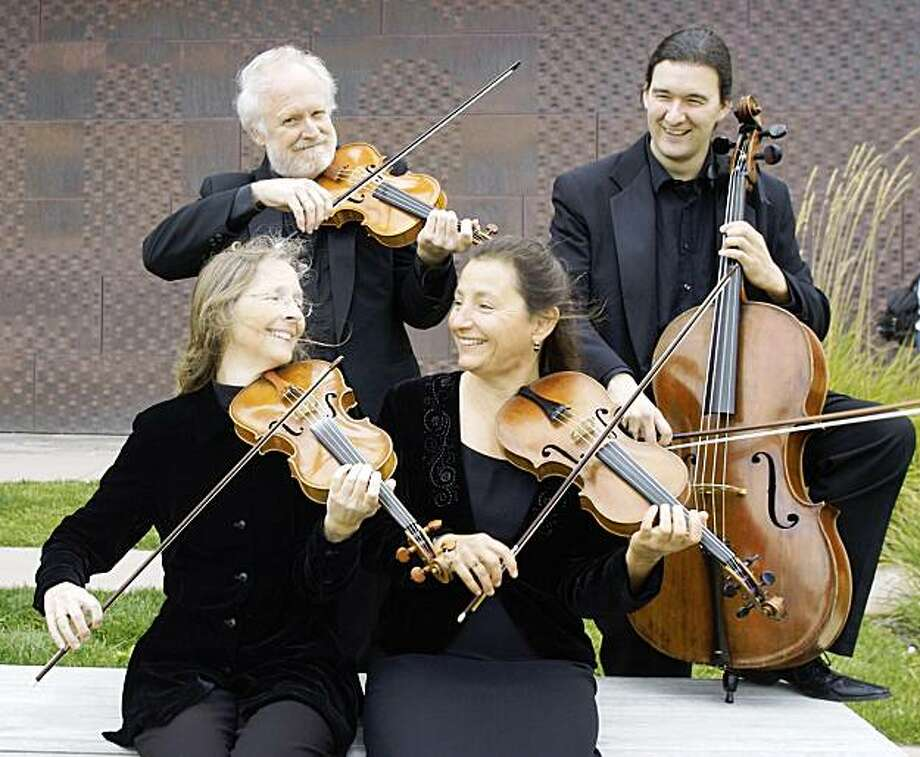 Members of the New Esterhazy Quartet include Lisa Weiss (left) and Kati Kyme, front, and Anthony Martin (left) and William Skeen, standing Photo: Courtesy, NEQ