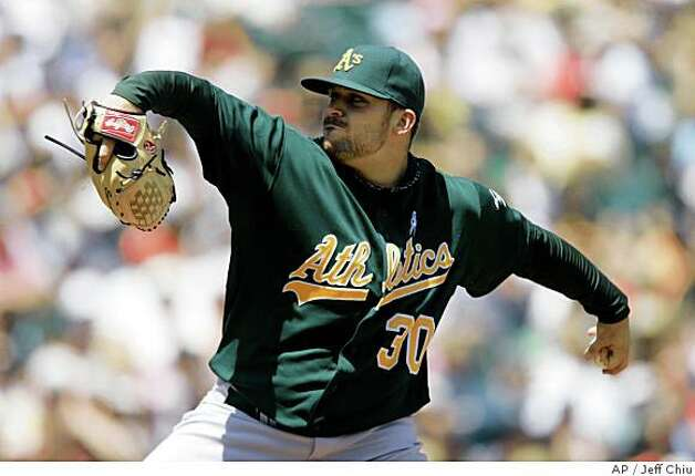 Oakland Athletics' Dana Eveland pitches to the San Francisco Giants in the fourth inning of a baseball game in San Francisco, Sunday, June 15, 2008. (AP Photo/Jeff Chiu) Photo: Jeff Chiu, AP