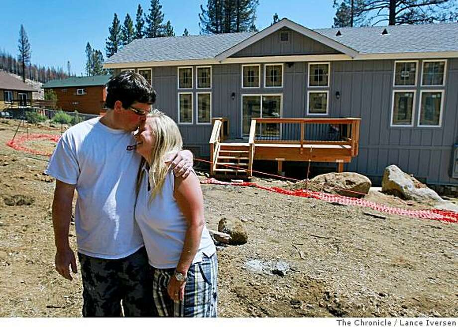 Mike and Tina Shannon in their backyard admiring the craftsmanship that's gone into its construction. The couple spends almost every weekend at their new home, as they look forward to its completion date of July 4th. On the eve of the one-year anniversary of South Lake Tahoe Angora Fire, that charred nearly 3,100 acres and destroyed 254 houses, South Lake Tahoe area now looks like a massive construction zone. Photographed in South Lake Tahoe Calif, Friday June 13, 2008. By Lance Iversen / The Chronicle Photo: Lance Iversen, The Chronicle