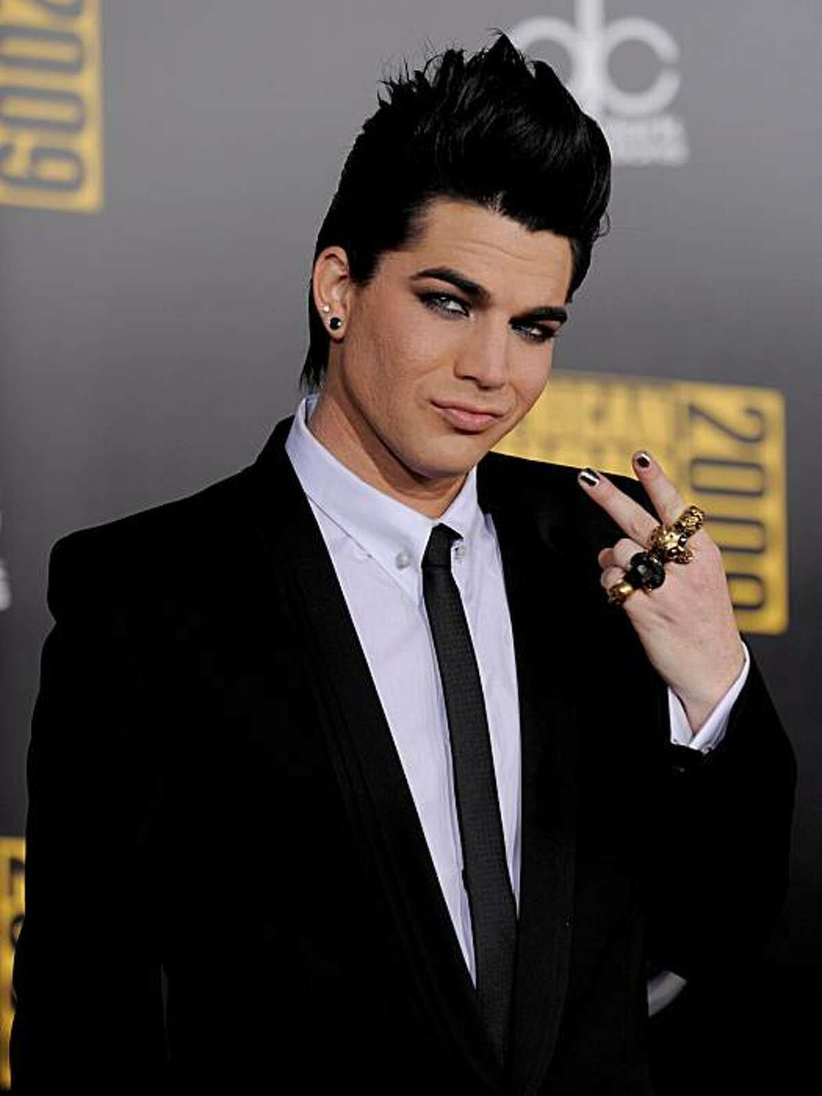 Singer Adam Lambert arrives at the 37th Annual American Music Awards on Sunday, Nov. 22, 2009, in Los Angeles.