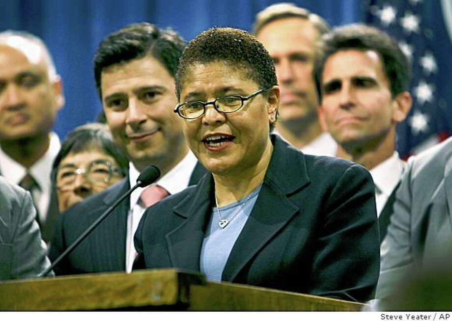 Assembly Majority Leader Karen Bass, D-Los Angeles, center, is joined by fellow legislators as she speaks at a news conference after she was elected to become the next speaker of the California State Assembly at the Capitol in Sacramento, Calif., on Thursday, Feb. 28, 2008.(AP Photo/Steve Yeater) Photo: Steve Yeater, AP